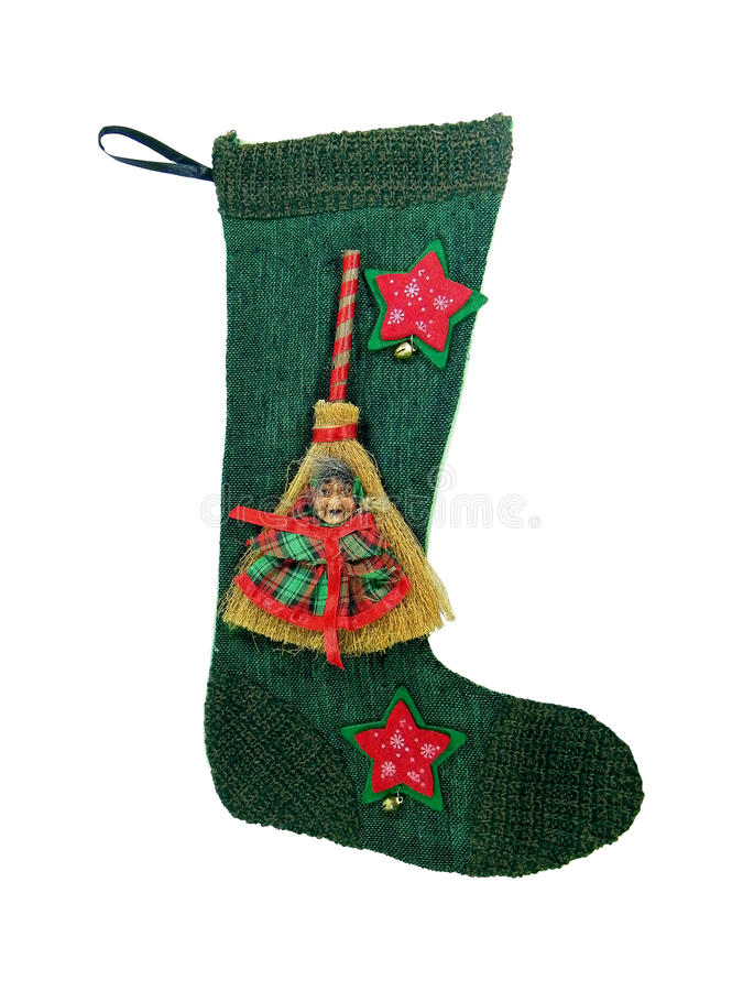 Epiphany Sock. Decorated with broom and old woman's face.In Italian tradition an old woman (called Befana) flying on a broom fills socks with sweets for good stock photos