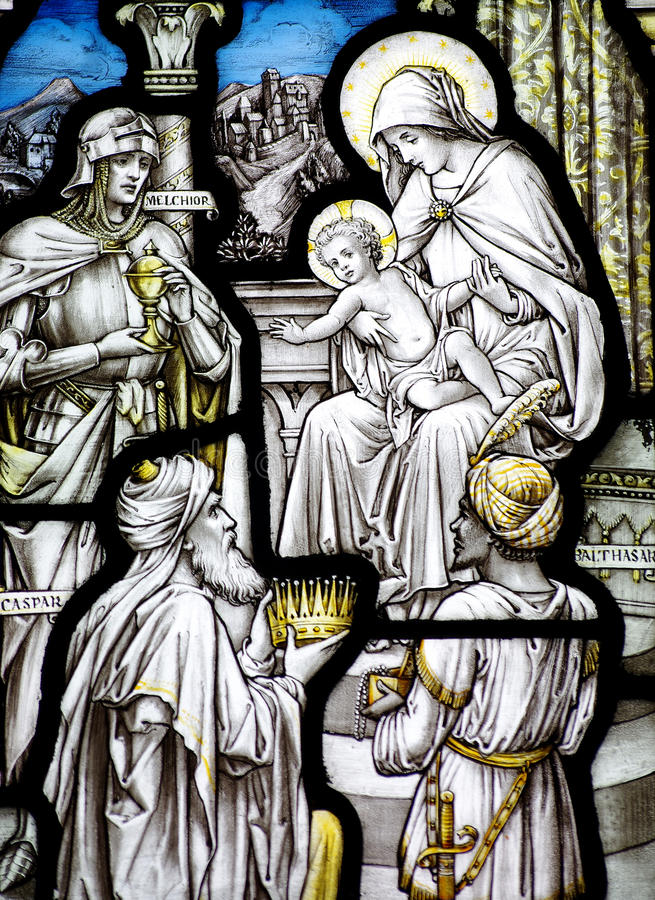 The Epiphany in stained glass (three kings visiting baby Jesus). A photo The Epiphany in stained glass (three kings visiting baby Jesus stock photography