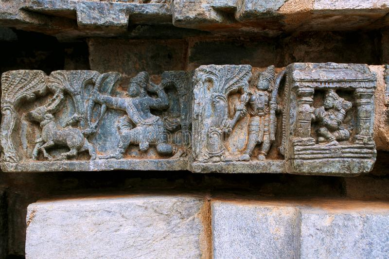 Laxmana leaving Sita in the kuti, Rama shooting arrow at Goden deer, Suvarna Mriga, carved on the Friezes at the base of temple. K. Episode from Ramayana, from stock photo