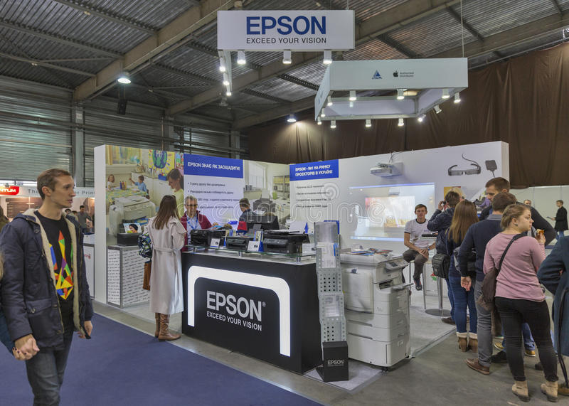 Epson company booth at CEE 2015, the largest electronics trade show in Ukraine. People visit Epson, Japanese printers and electronics company booth during CEE stock photos