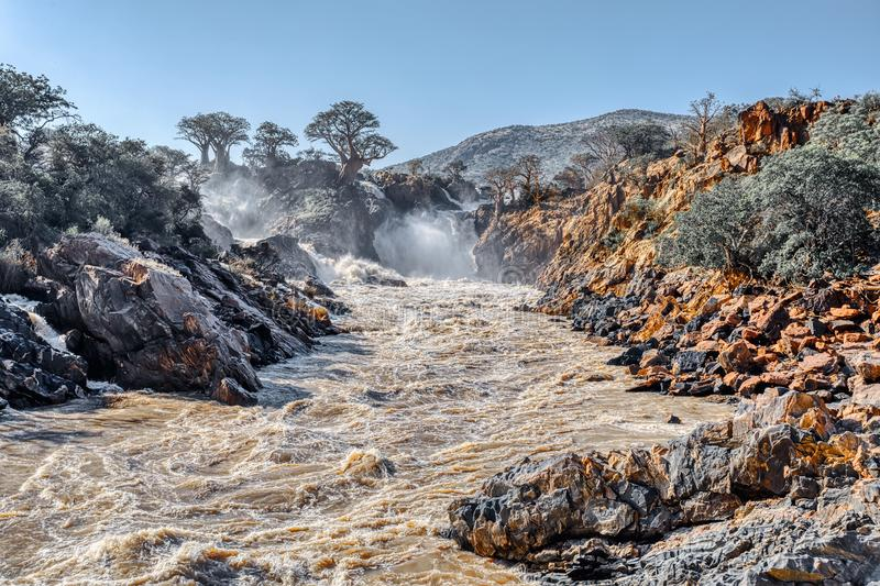 Epupa Falls on the Kunene River in Namibia. Beautiful Epupa Falls on the Kunene River in Northern Namibia and Southern Angola border. Sunrise sunlight in water royalty free stock image