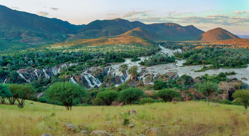 Epupa Falls on the Kunene River in Namibia. Epupa Falls on the Kunene River in Northern Namibia and Southern Angola border. Sunset sunlight with water mist. View stock photos