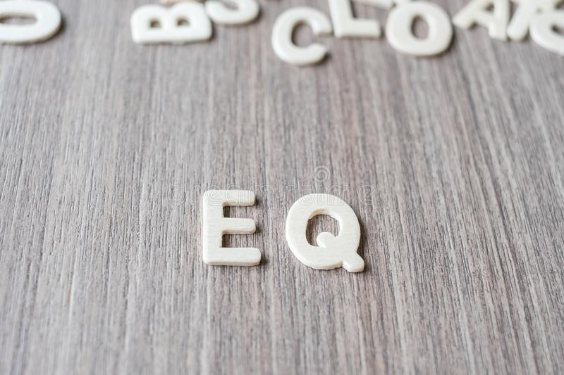 EQ word of wooden alphabet letters. Business and Idea. Concept stock image