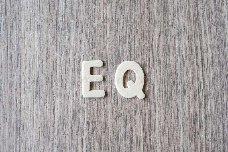 EQ word of wooden alphabet letters. Business and Idea. Concept stock photography