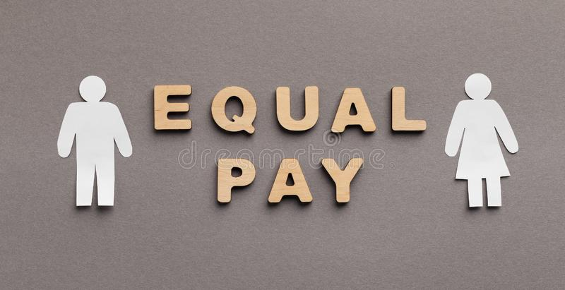Equal Pay for man and woman concept royalty free stock photography