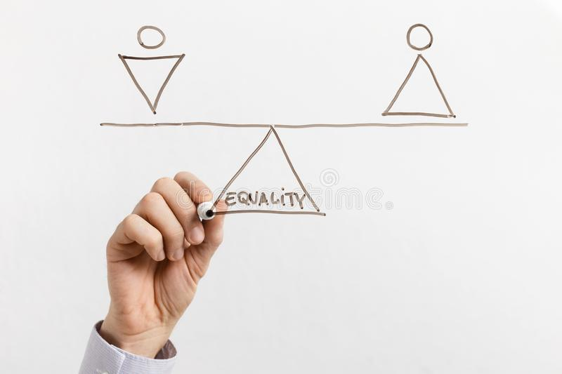 Equality between men and women on glass board stock images