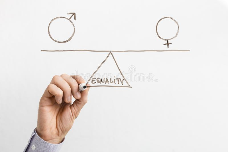Equality between men and women on glass board royalty free stock photos