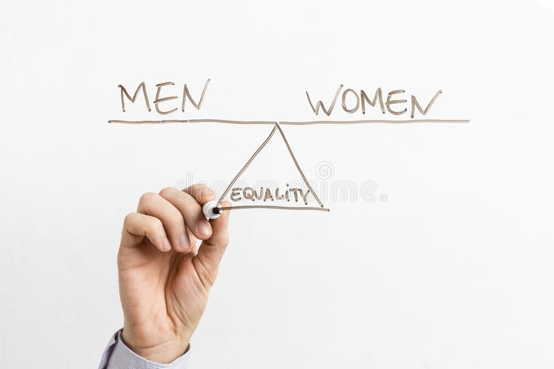 Equality between men and women on glass board stock photo