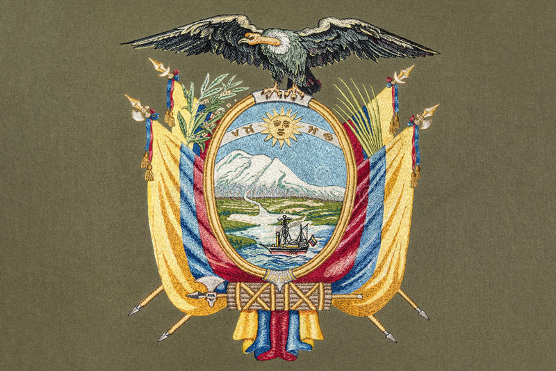 Equator coat of arms. Embroidery of Equator coat of arms on gray fabric royalty free stock images