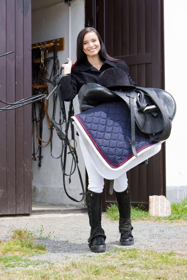 Equestrian con la sella fotografia stock