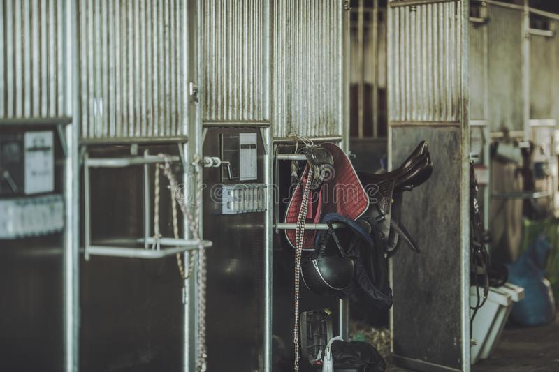 Equestrian Facility Horse Barn. Animal Boxes and Some Riding Equipment royalty free stock photography