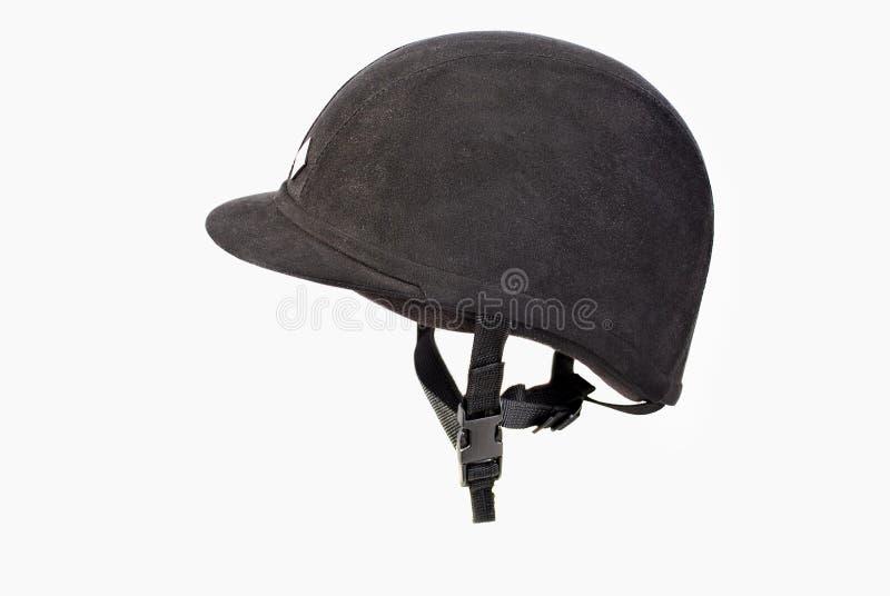 Equestrian helmet. Black equestrian helmet on a bright background royalty free stock image