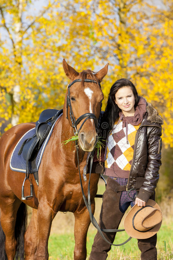 Equestrian with her horse stock photography
