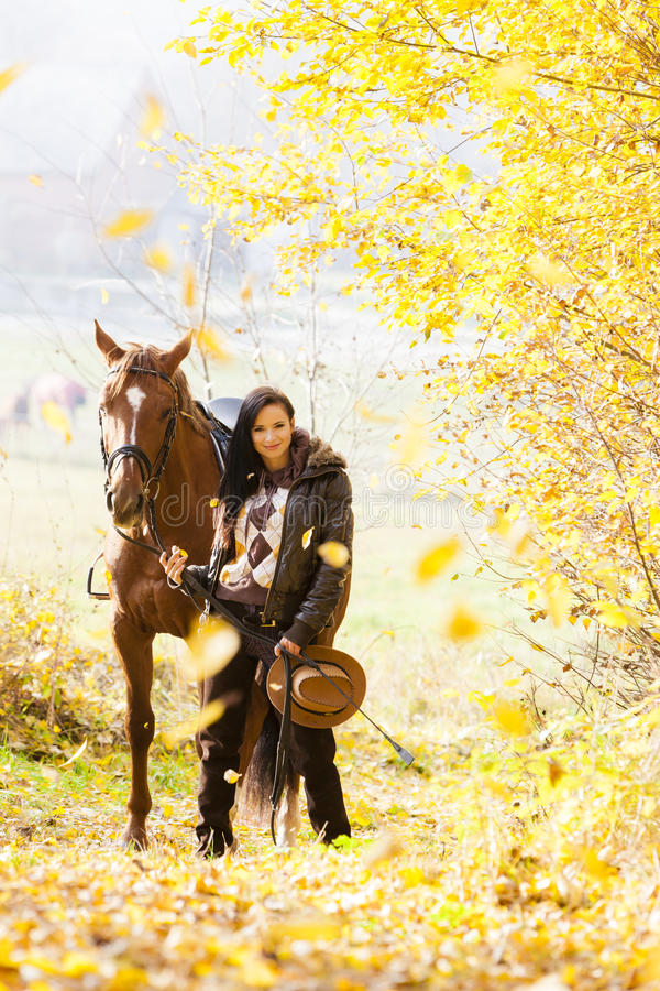 Equestrian with her horse stock image