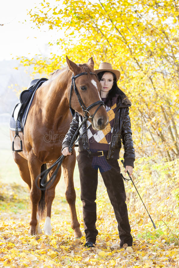 Equestrian with her horse royalty free stock photography