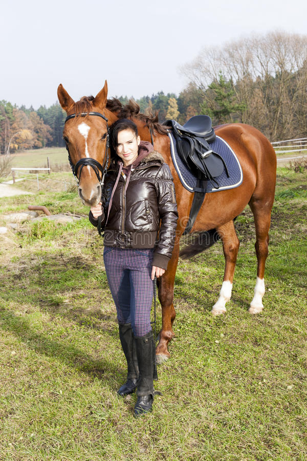 Equestrian with her horse royalty free stock photos