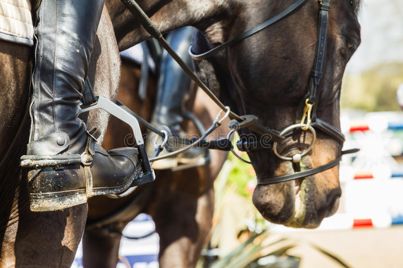 Equestrian Horse Rider Boots Closeup. Equestrian Rider boots accessories closeup detail and horse show jumping close-up stock photography