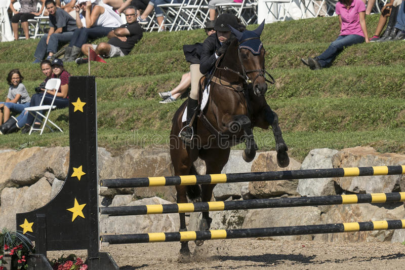 Equestrian. Picture of horse and rider making a jump during competition at the bromont concours June 12, 2016 royalty free stock photography