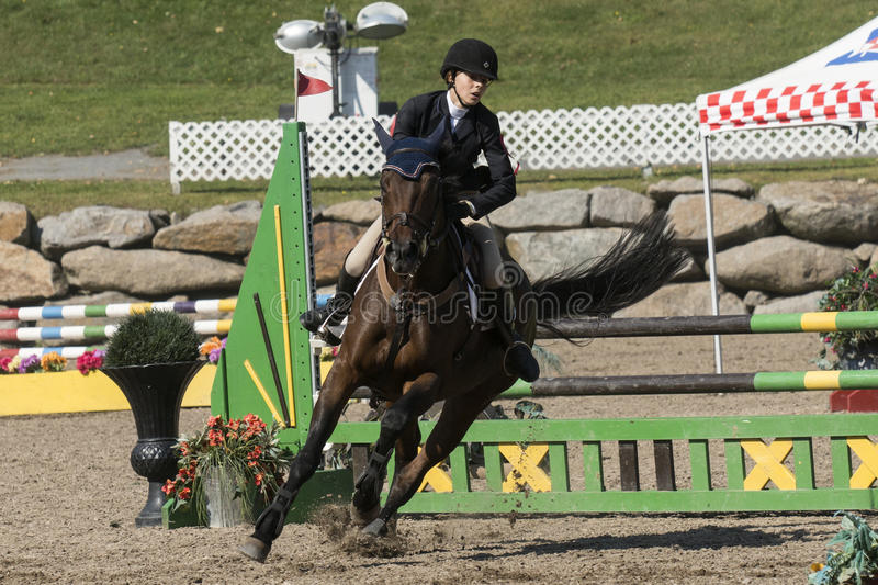 Equestrian. Picture of rider and horse completing a jump during competition at the bromont concours June 12, 2016 royalty free stock photography