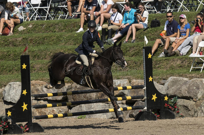 Equestrian. Picture of rider with horse jumping the fence during competition at the bromont concours June 12, 2016 stock photos