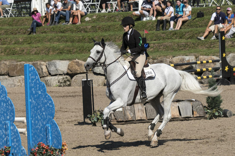 Equestrian show. Picture of rider and white horse during competition at the bromont concours June 12, 2016 royalty free stock photos