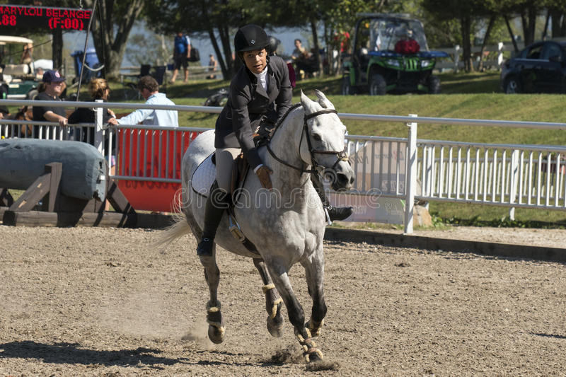 Equestrian show. Picture of rider and white horse during competition at the bromont concours June 12, 2016 stock image
