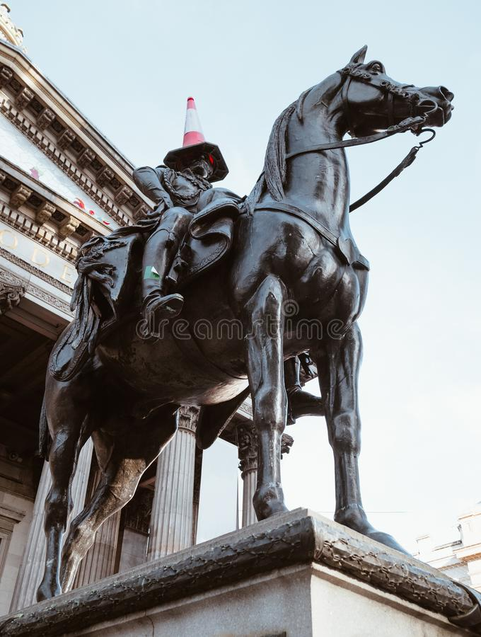 Equestrian statue of the Duke of Wellington in  Glasgow, Scotland,United Kingdom famous for a. `traffic cone` headdress stock images