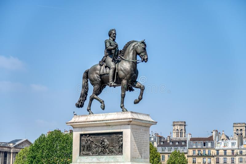 Statue of Henry IV by Pont Neuf - Paris, France. Paris, France, April 30, 2019: Equestrian statue of Henry IV by Pont Neuf - Paris, France royalty free stock photos