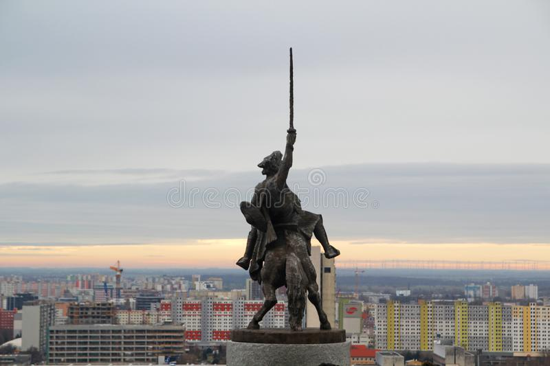 Equestrian statue of King Svatopluk I and Bratislava panorama. Equestrian statue of King Svatopluk I in the yard of Bratislava castle and the city panorama stock photography