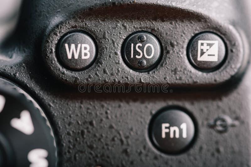 Equilibrio blanco, ISO y botón de la remuneración de la exposición en la cámara digital fotos de archivo