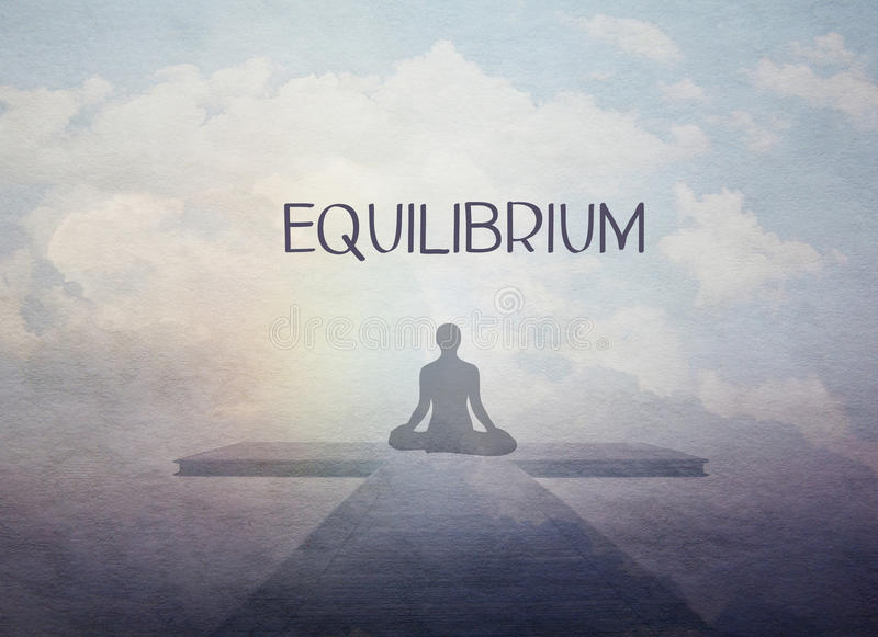 Equilibrium concept. Vintage equilibrium and inner harmony concept. Female yoga figure against blue sky background royalty free stock images