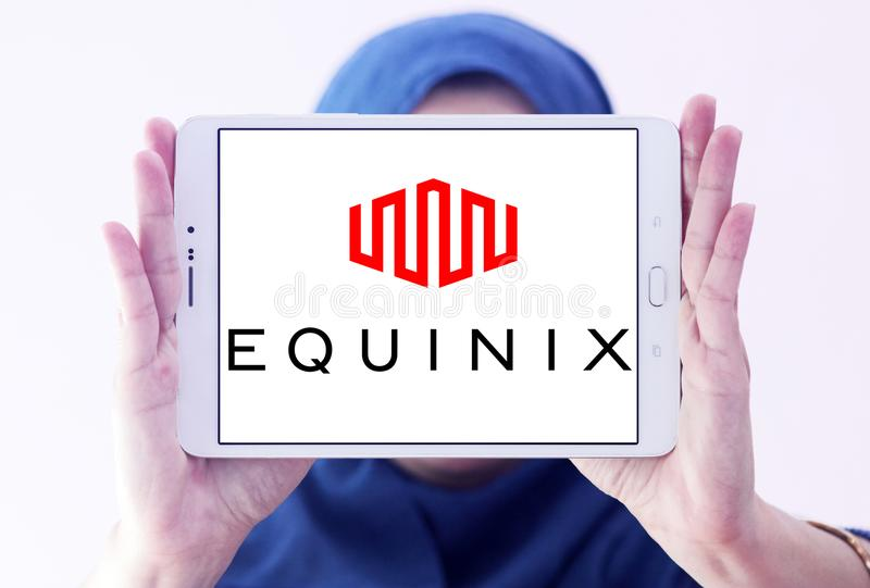 Equinix internet company logo. Logo of Equinix internet company on samsung tablet holded by arab muslim woman. Equinix, Inc. is an American multinational company stock images