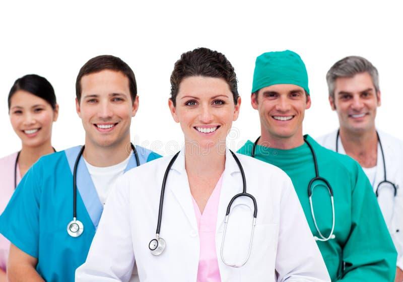 Equipa médica de sorriso no hospital fotos de stock royalty free