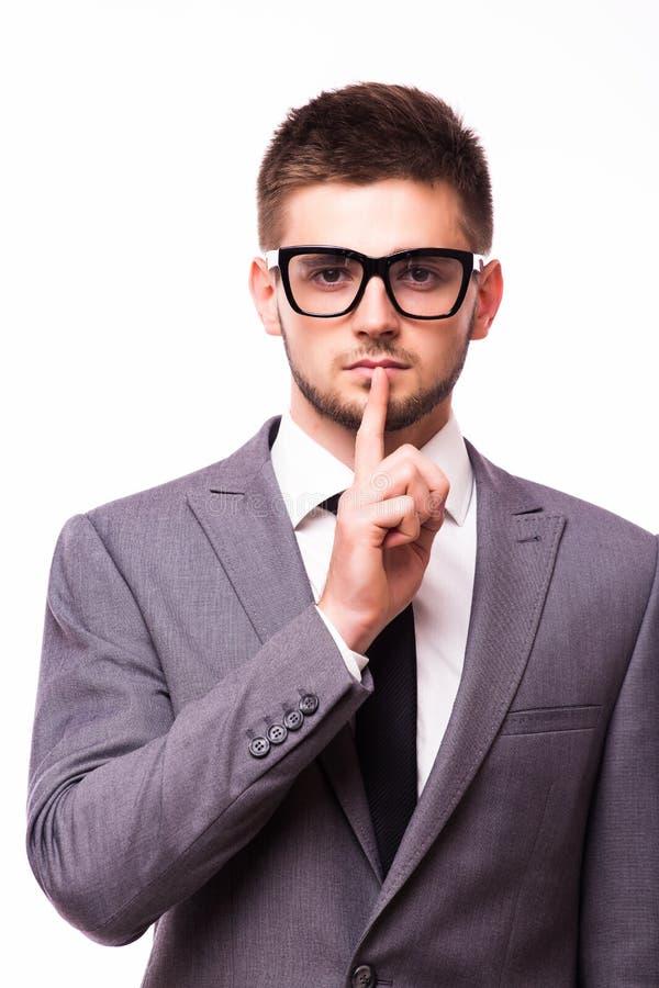 equipaggi indicare il dito sopra le labbra, chiedenti il silenzio immagini stock