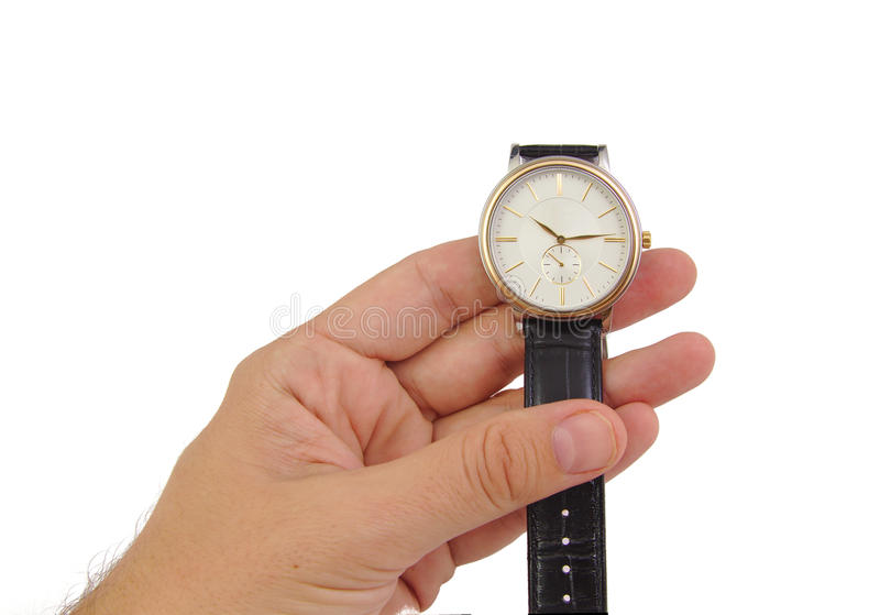 Equipaggi la mano con l'orologio isolato su fondo bianco immagini stock libere da diritti