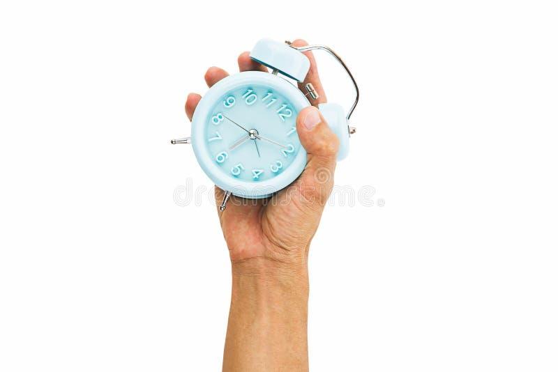 Equipaggi la sveglia della tenuta della mano isolata su fondo bianco immagini stock