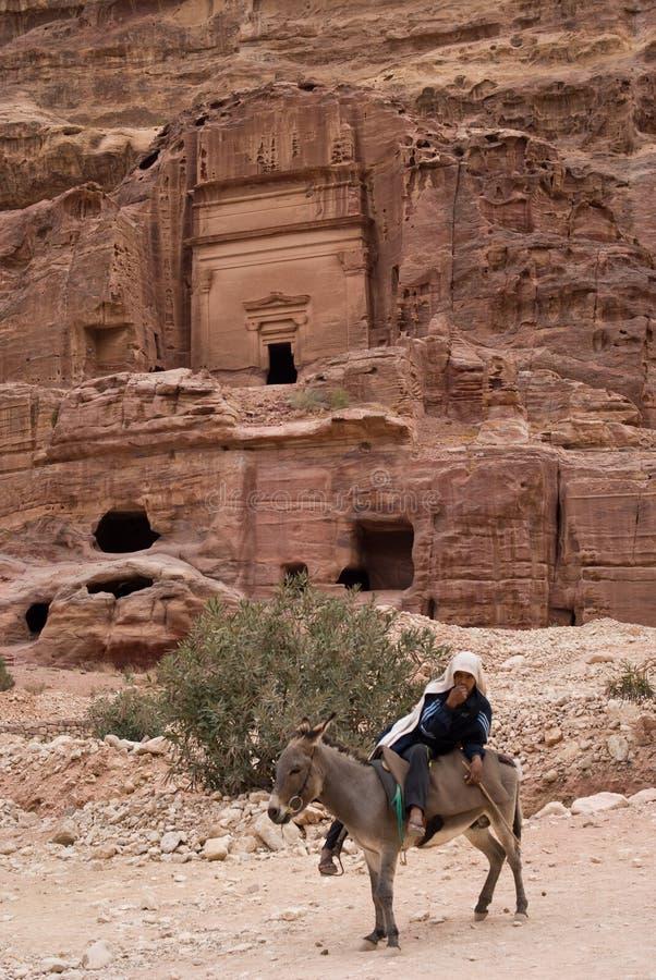 Equipaggi sugli asini Petra Jordan fotografia stock libera da diritti