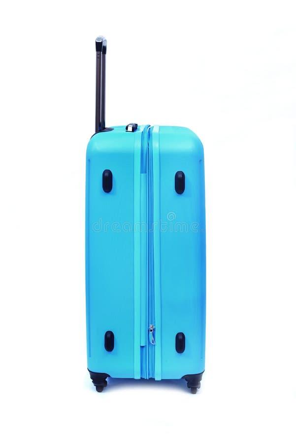 Equipaje azul aislado imagen de archivo libre de regalías