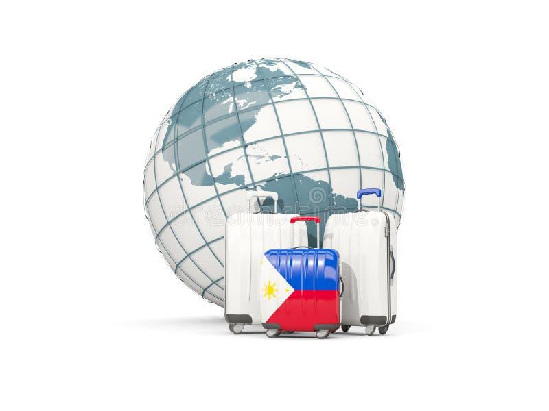 Equipaje con la bandera de Filipinas Tres bolsos delante del globo ilustración del vector