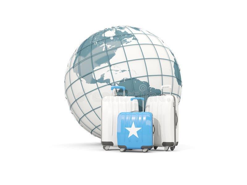 Equipaje con la bandera de Somalia Tres bolsos delante del globo ilustración del vector