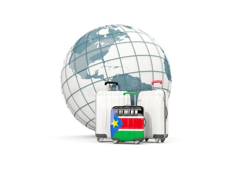Equipaje con la bandera de Sudán del sur Tres bolsos delante del globo libre illustration