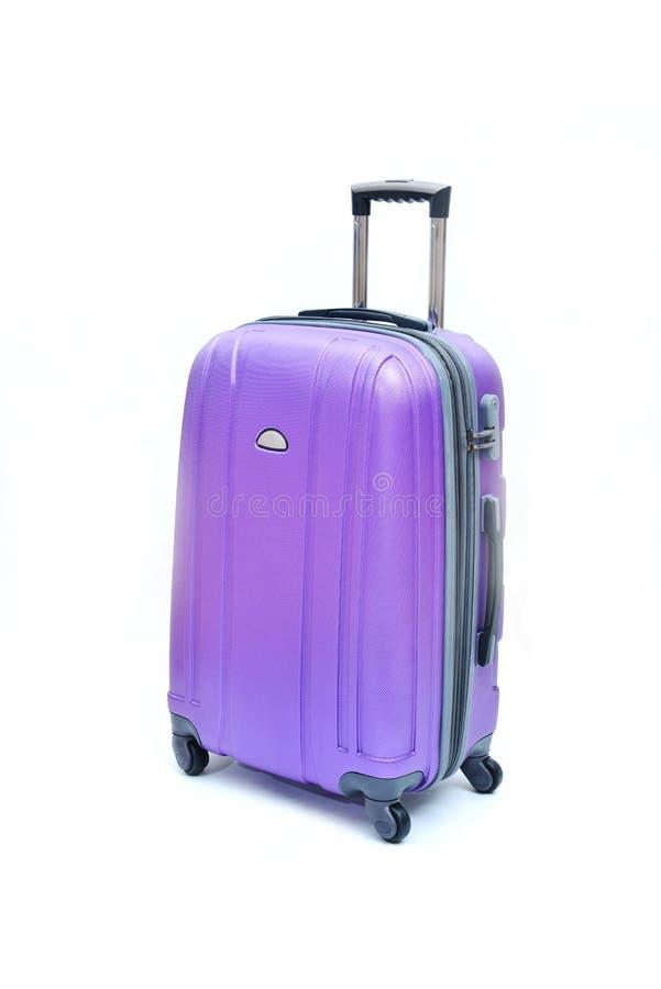 Equipaje púrpura aislado imagen de archivo