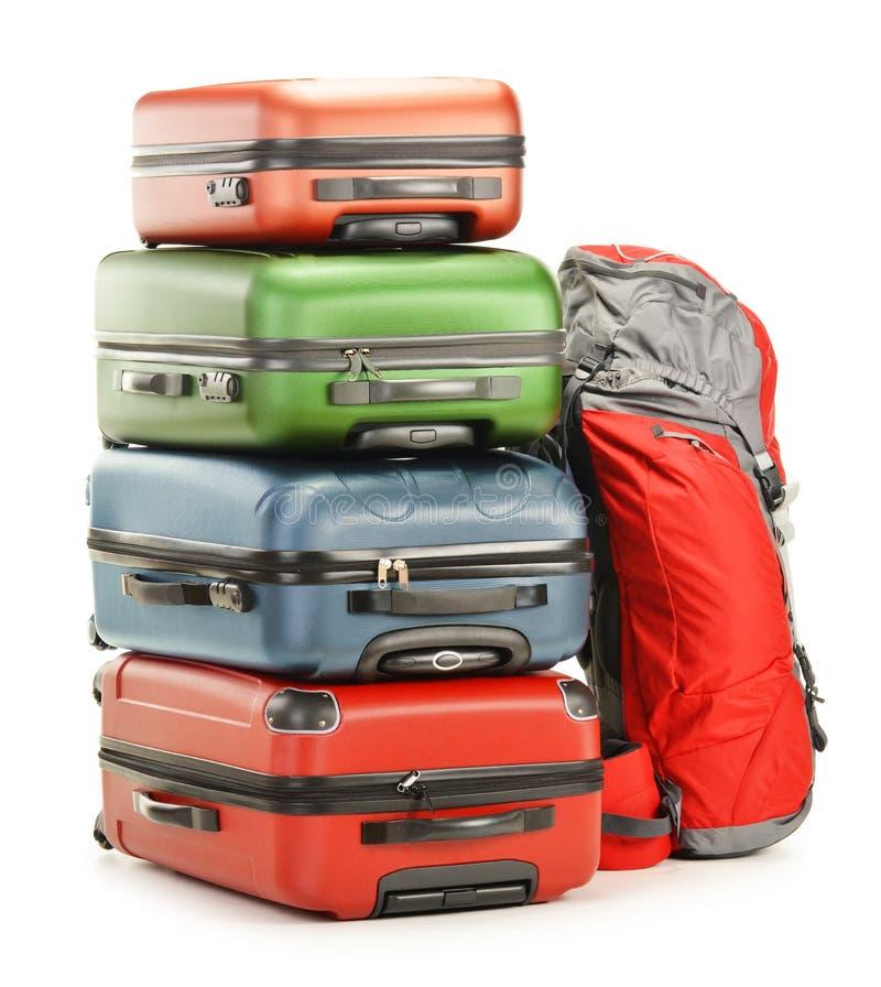 Equipaje que consiste en las maletas y la mochila grandes foto de archivo libre de regalías