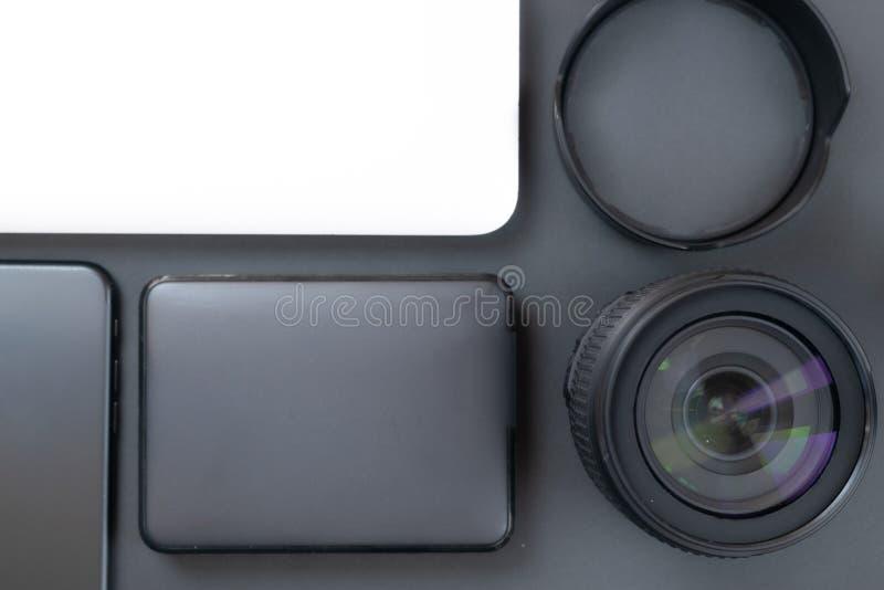 Equipamento da foto na tabela imagens de stock