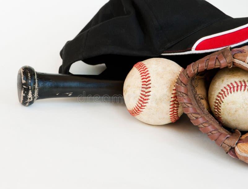Equipamento de basebol com bastão preto fotos de stock