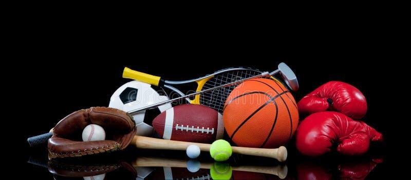 Equipamento de esportes Assorted no preto foto de stock royalty free