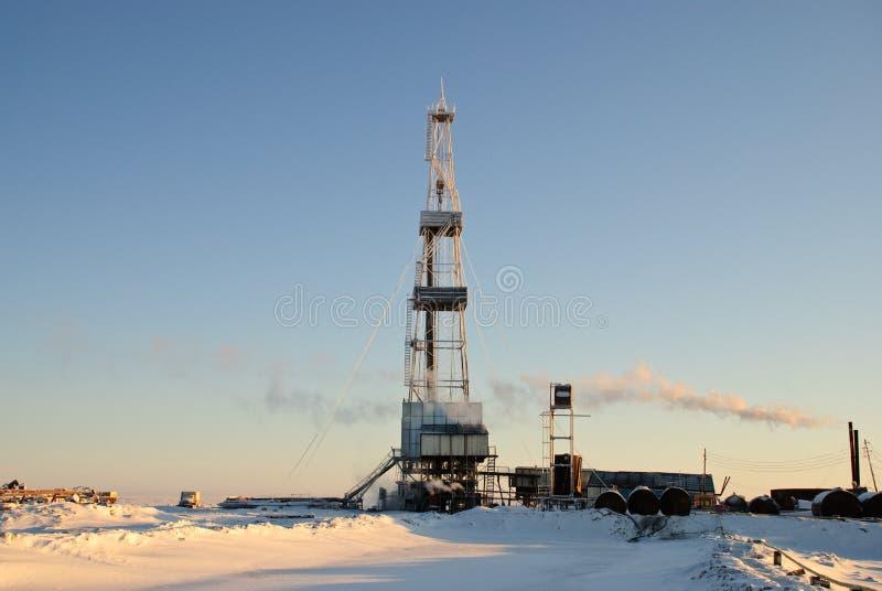 Equipamento de perfuração do inverno foto de stock