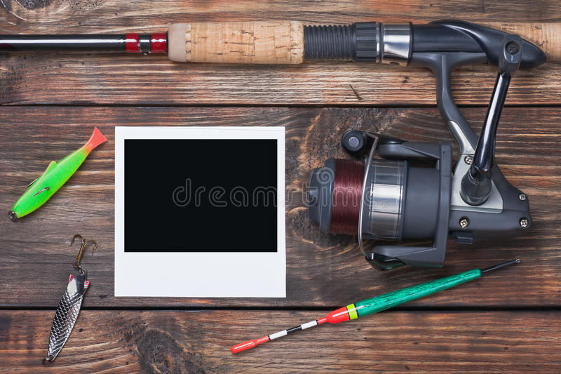 Equipamento de pesca e photoframe imagens de stock