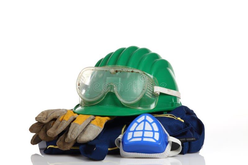 Equipamento de segurança verde do capacete imagem de stock