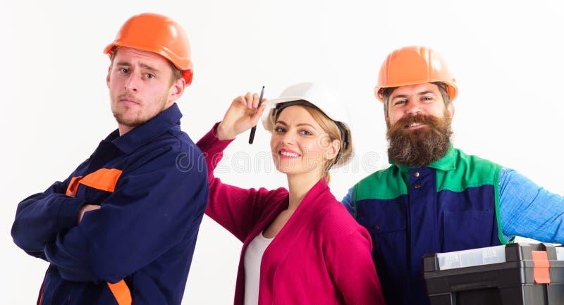 Equipe alegre dos arquitetos prontos para trabalhar, fundo branco isolado imagem de stock